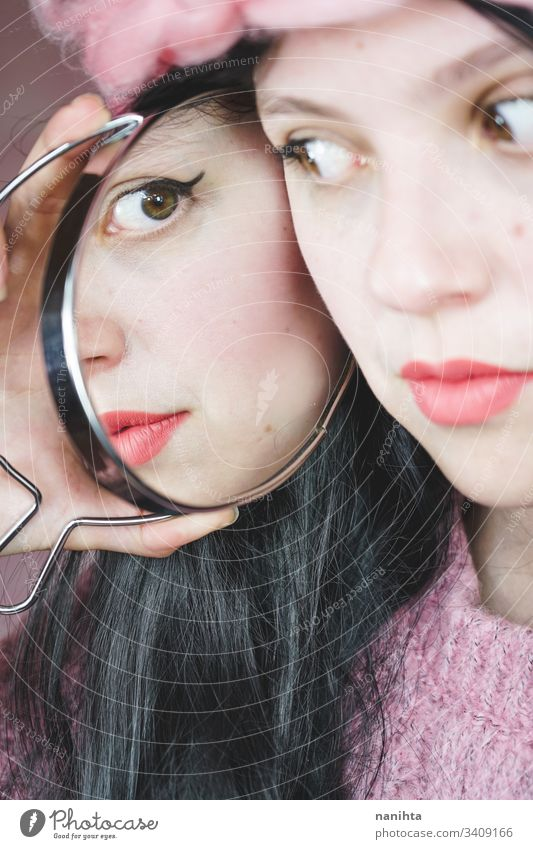 Close up of a beautiful woman reflected in a mirror beauty cosmetics lipstick close up young fashion trendy cool reflection brunette sensual face pretty youth