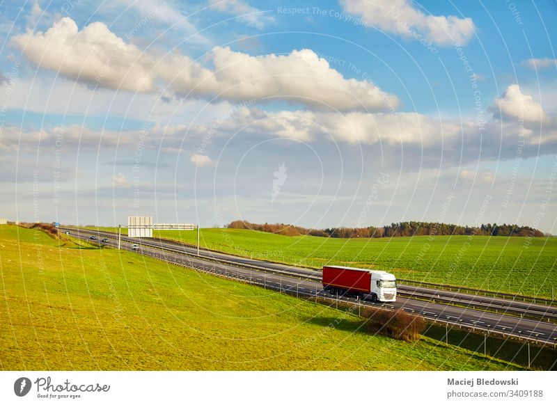 Rural landscape with a highway in the spring. truck transport road outdoors supply chain logistics lorry drive trailer transportation vehicle shipping
