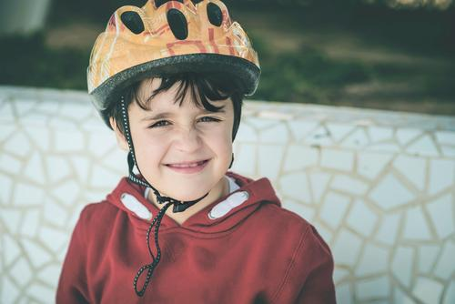smiling Child with bicycle helmet child cyclist Protection activity cycling security sport fun Happy Happiness Smiling Smile Healthy leisure Athlete drop