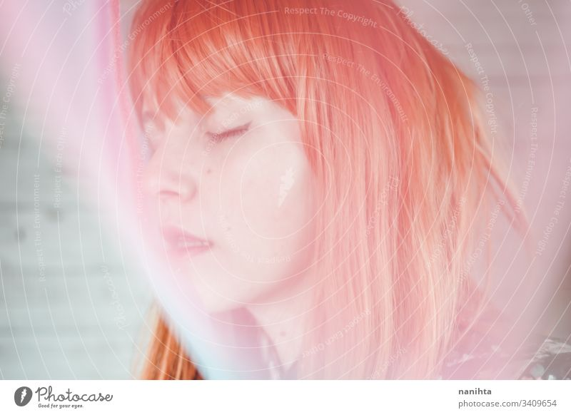 Romantic and dreamy portrait of a redhead woman young blur blurry effect creative creativity pastel tones pretty face mood moody daydream daydreamer art