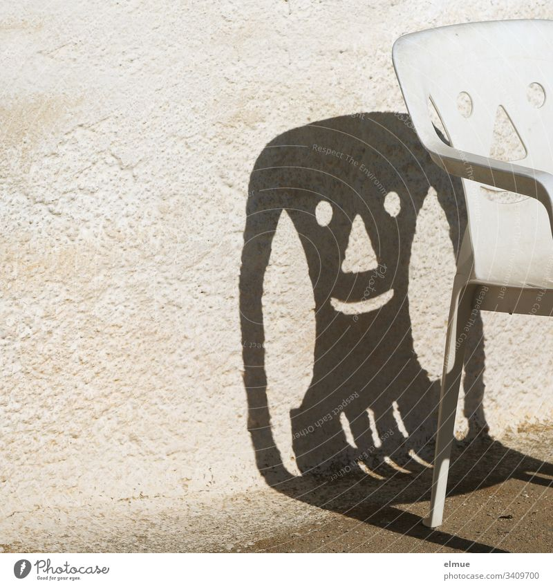 funny shadow of a plastic chair Chair Plastic chair Camping chair Shadow Laughter Face Wall (barrier) Happiness smile Furniture Deserted Exterior shot