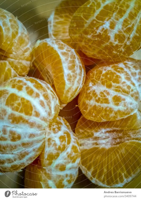 View of small peeled oranges food natural delicious fresh fruit health sweet nutrition tangerine green mandarins pile of oranges small orange healthy tropical