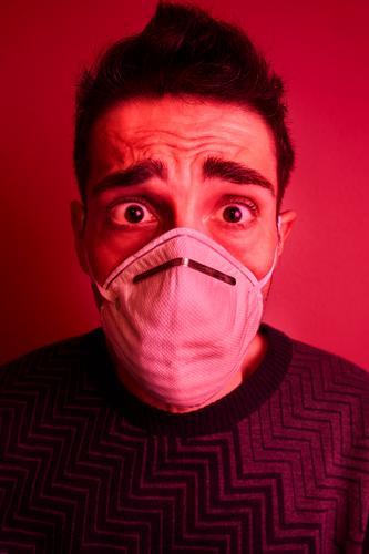 Man scared by coronavirus with a face mask Coronavirus COVID-19 Wuhan corona virus protection crisis panic danger infection environment contagion pharmacy