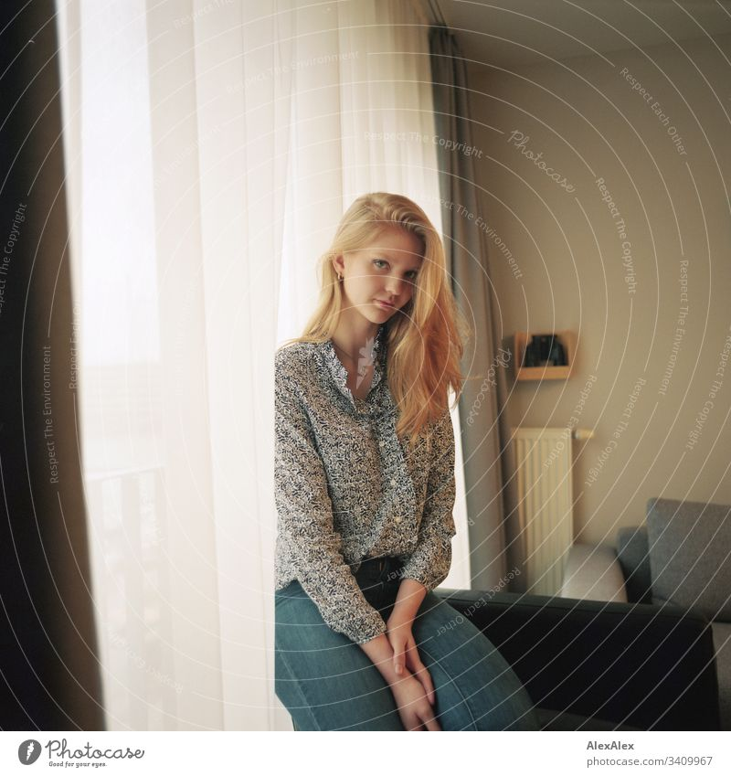 Portrait of a young woman beside the window at the curtain Woman Girl Blonde Beautiful youthful Slim daintily Elegant Lifestyle dwell Flat (apartment) at home