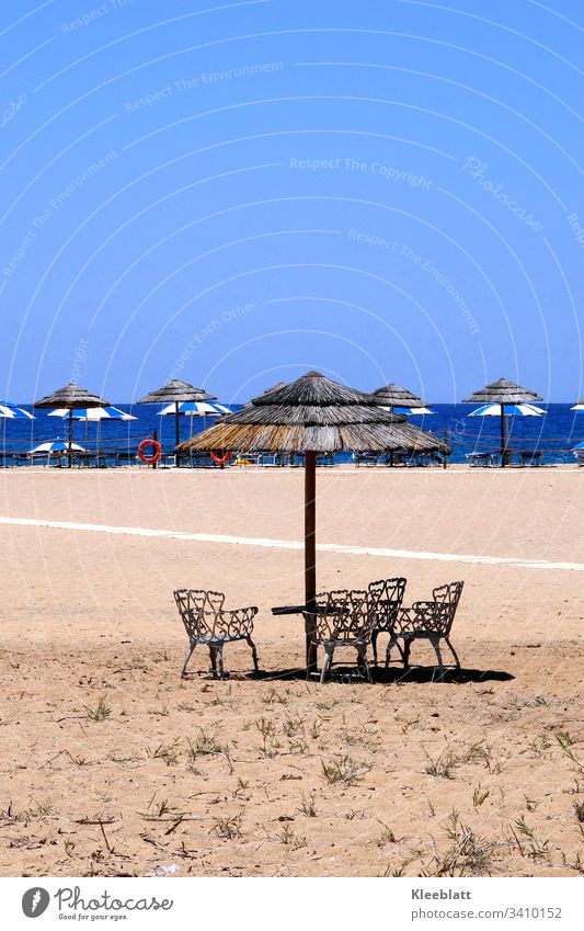 Sand beach chairs straw umbrellas Blue and beige Vacation & Travel Summer Tourism Ocean Relaxation Deserted Place in the sun Beach Beautiful weather
