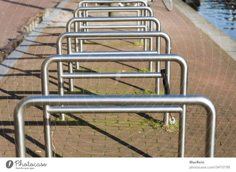 bicycle stands Bicycle rack bicycles bike Keep Lean switch off Parking lot Handrail steel pipe Metal nobody Copy Space