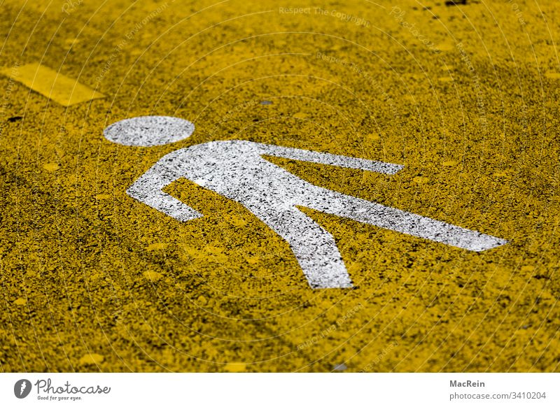 Pedestrian Pictogram pictogram Road marking Direction Information Signage visualization stylized symbol Asphalt Street tarred road Yellow nobody Copy Space