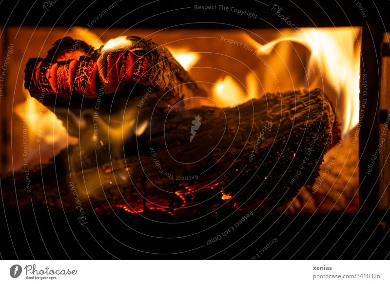 Fire in the fireplace Fireside log Hot ardor blaze Yellow Black Embers Environmental pollution Wood Open fire Fireplace Blaze Flame Burn Orange Firewood Heat