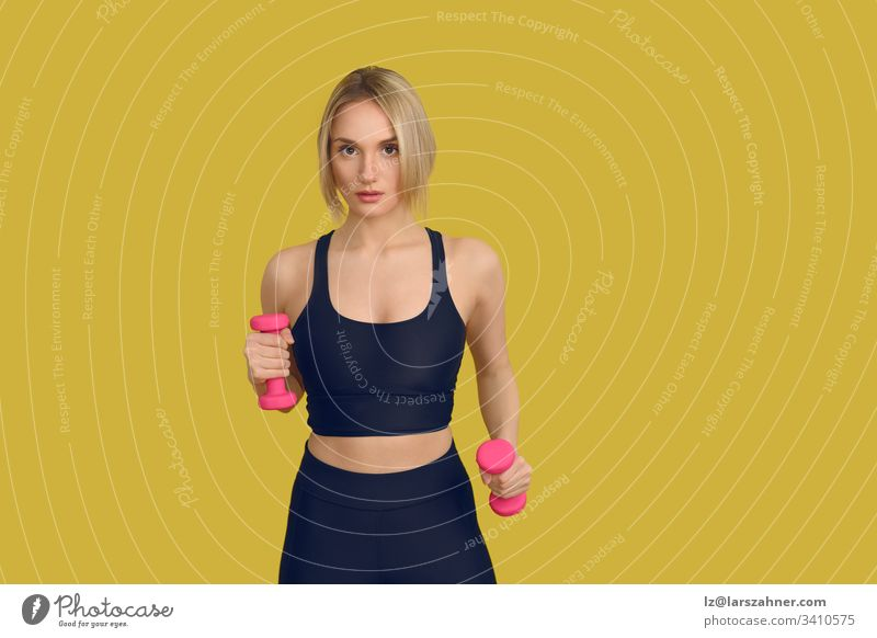 Pretty blonde woman with pink dumbbells Close-up active Attractive Beautiful Black Blonde Body Cute Dumbbells tutorial Fitness Front side Gymnastics hands