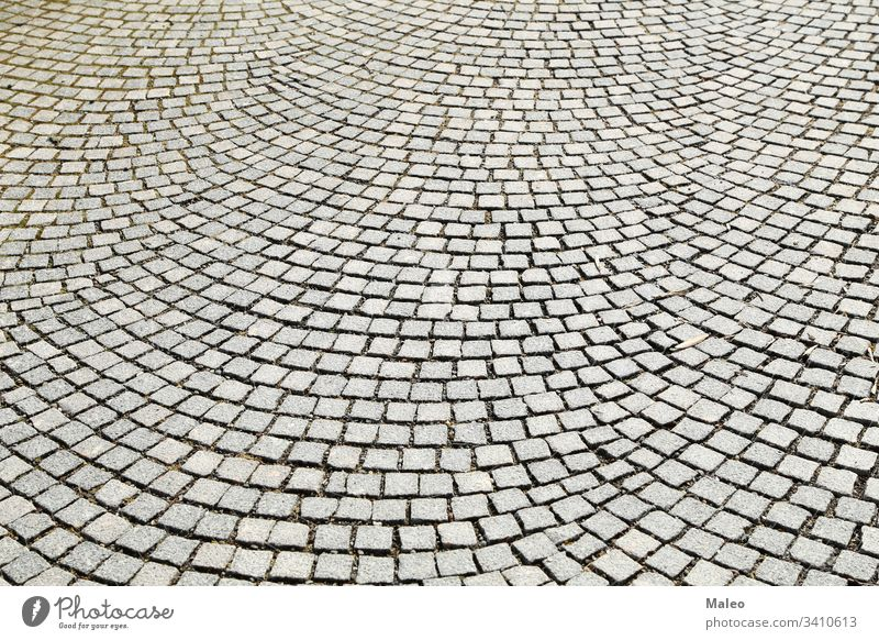 Abstract background of old cobblestone pavement close-up abstract abstracts architecture block brick bricks conceptual construction contrast detail flat floor