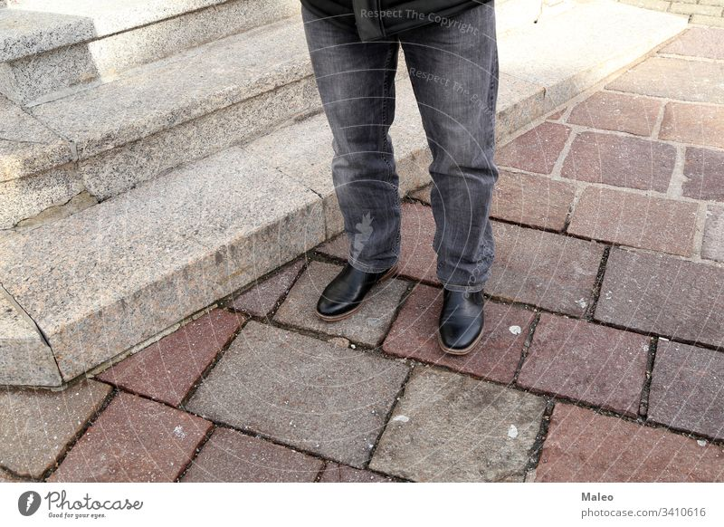 Legs in jeans and black shoes at the granite steps fashion foot footwear legs style urban beautiful city close female girl gray leather stone street walk woman