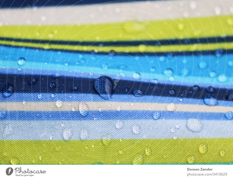 Drops of water on an umbrella raindrops Exterior shot Nature Rain background Water Umbrella Wet Colour photo Weather Close-up Day Bad weather Striped Detail