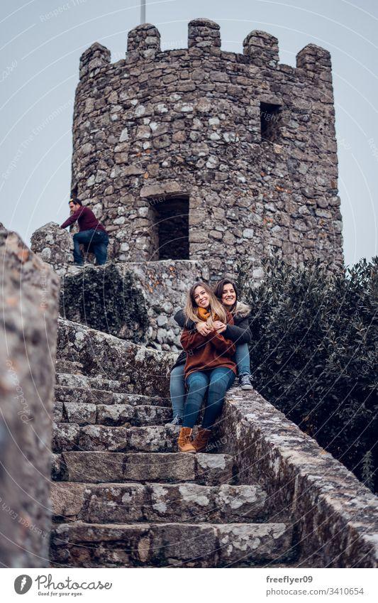 Two friends enjoying Moorish Castle in Sintra, Portugal landscape tour tourism castelo architecture moorish horizontal history historical building lisboa mouros