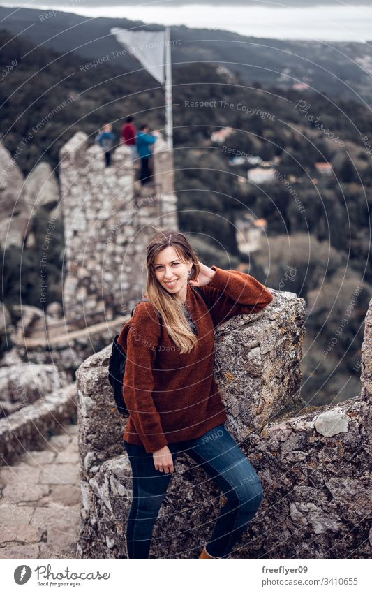 Young woman enjoying Moorish Castle in Sintra, Portugal landscape tour tourism castelo architecture moorish horizontal history historical building lisboa mouros