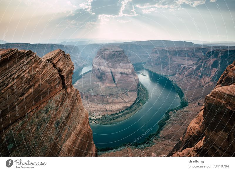 Horseshoe Bend with sunrays in the sky Mountain stream Mountain torrent Flow Nature Reflection Untouched river Colorado River Page Americas National Park USA
