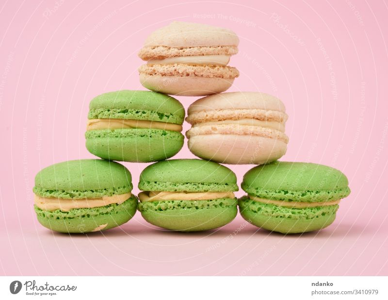 stack of white and green round almond flour cakes macarons assorted assortment bake bakery biscuit candy closeup color confection confectionery cookie cream