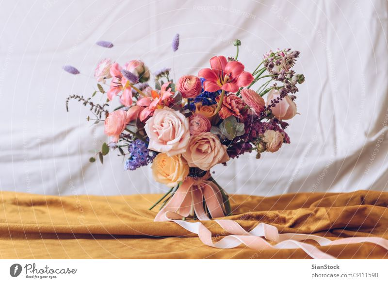 Still life with a beautiful bouquet of flowers table vase wedding decoration white background interior arrangement dinner romantic pink rose design floral event