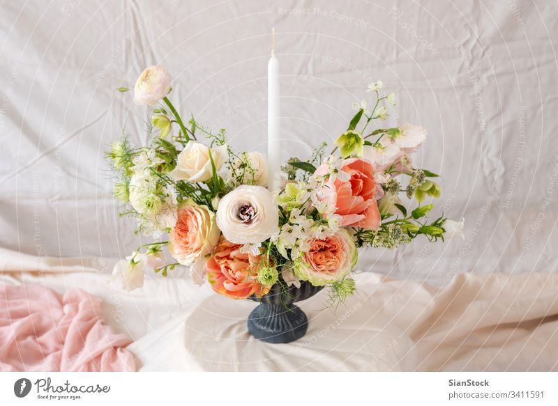 Still life with a beautiful bouquet of flowers table vase candles wedding decoration white background interior arrangement dinner romantic pink rose design