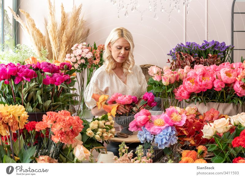 Beautiful blonde florist woman create wonderful bouquet Happy Hand Wedding Dress Retro Style Adults Bouquet Modern Cute Woman Brunette Soft Blue Pink Hold