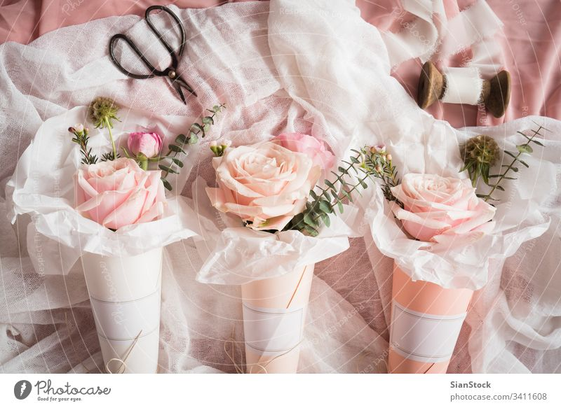 Bouquets of flowers  in  paper cones white cornets rose roses pastel background bouquet isolated valentine day pink green spring floral summer top beautiful