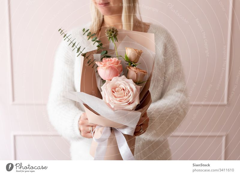 Woman holding a bouquet of roses flowers hand woman beautiful background floral white gift giving fresh spring female pink day beauty paper love green blossom