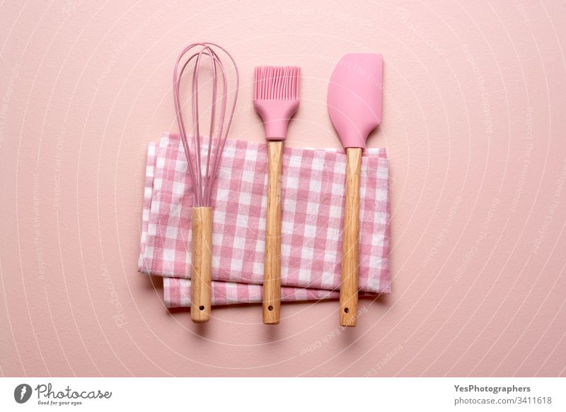 Kitchen utensils on a pink table. Colorful baking tools clean colorful concept cooking flat lay household kitchen kitchenware minimal minimalist mixer napkin