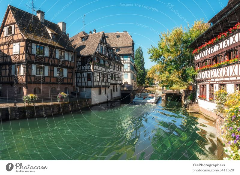 Strasbourg landscape on a sunny day. Ill river boat ride france alsace strasbourg alsatian french ill summer architecture houses spring hoolidays travel