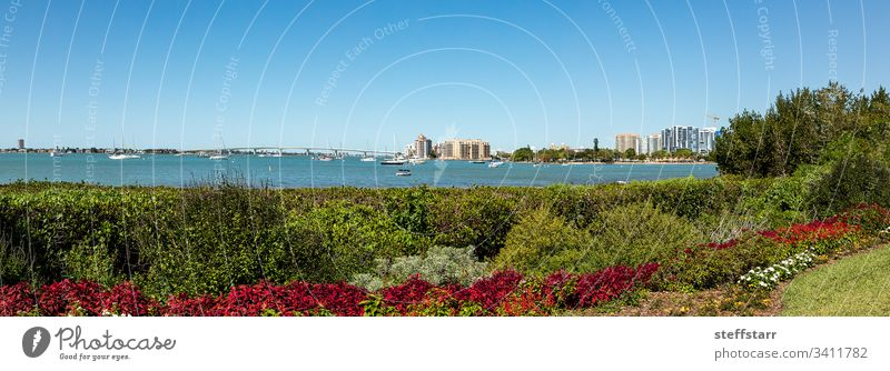Sarasota Bay with the John Ringling Causeway bridge in the background Bench view boat sailboat boats bay seat chair rest waterfront view Florida tranquil calm