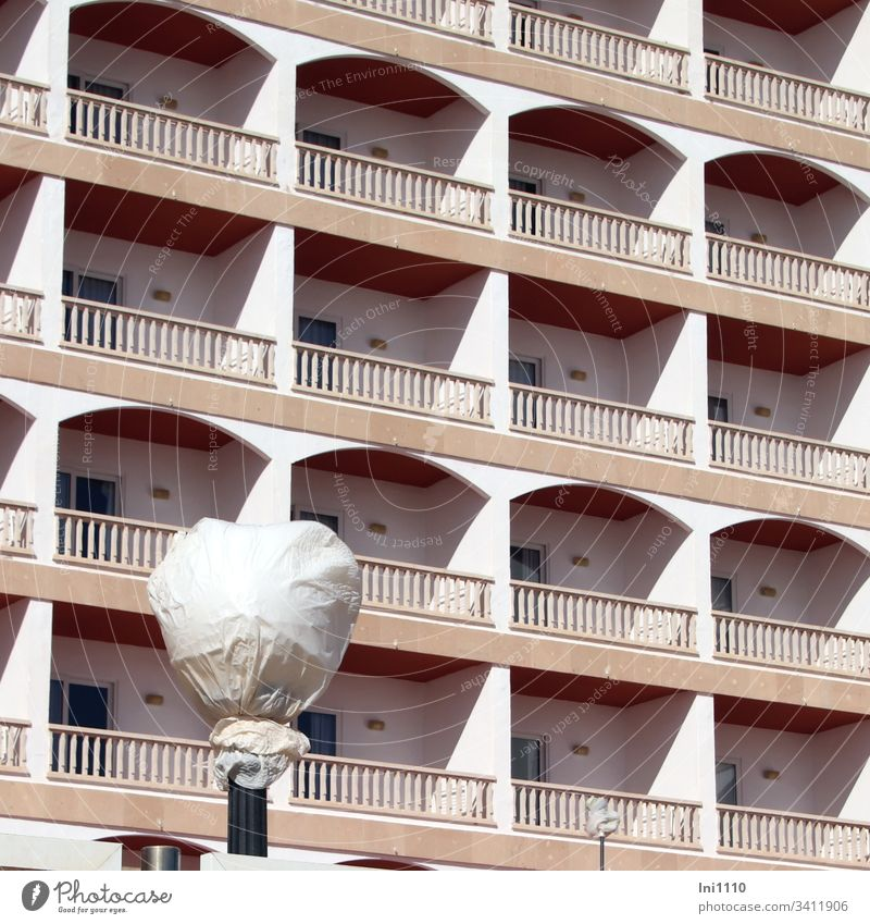 """white """"veiled"""" with bar in front of the balconies of a high-rise building facade white foil pole Balconies High-rise facade Hotel window Boarding house"""