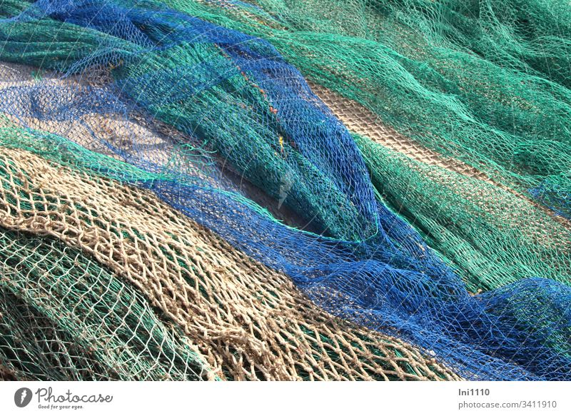 coloured fishing nets are lying on the quay for repair Majorca Fishing net Blue Green Beige Repair Harbour Craft (trade) seafaring Fisherman Profession meshes
