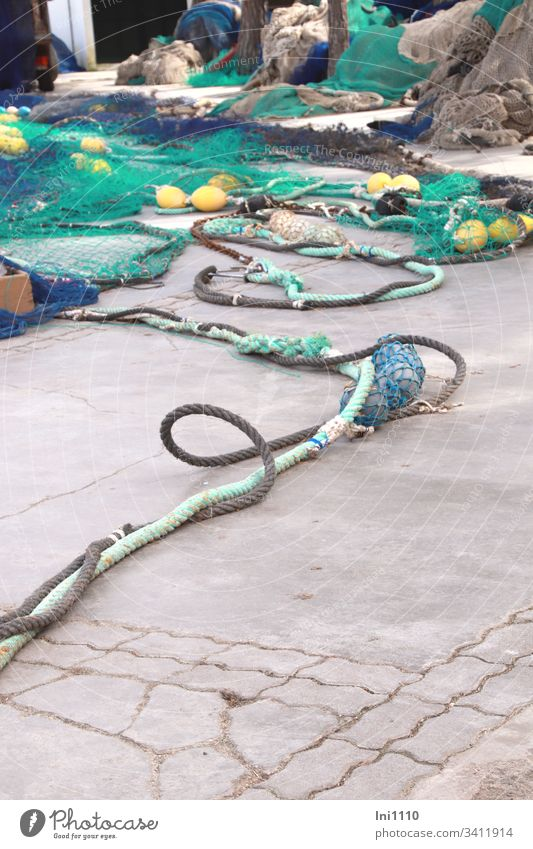 rope team | colourful fishing nets with thick coloured ropes and fishing balls lie on quay wall Sea Colours Disperse Blue Turquoise Yellow Fishing net Loop