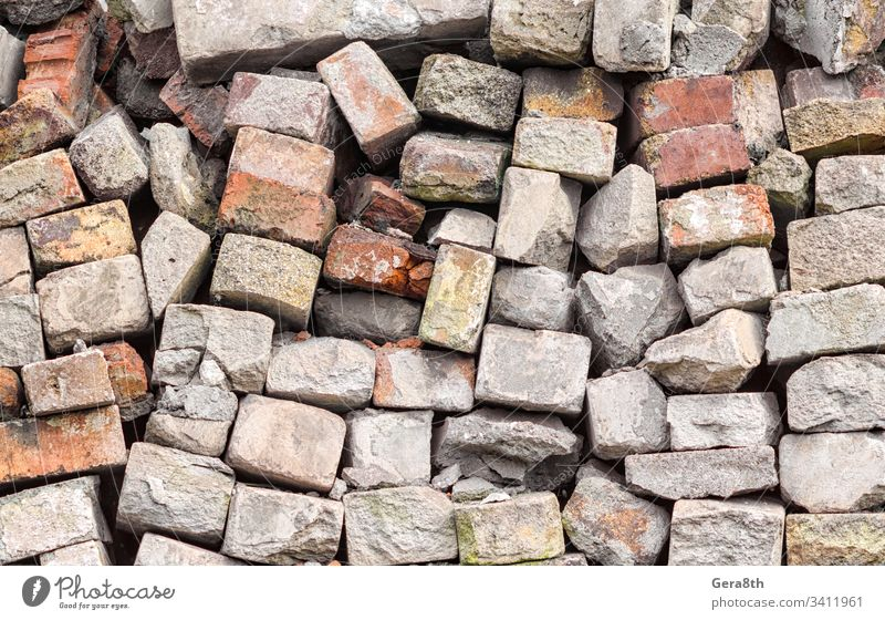 chaotic heap of old stone brick close up abstract backdrop background blank block brick pattern broken building chaos clutter coarse confusion crude detailed