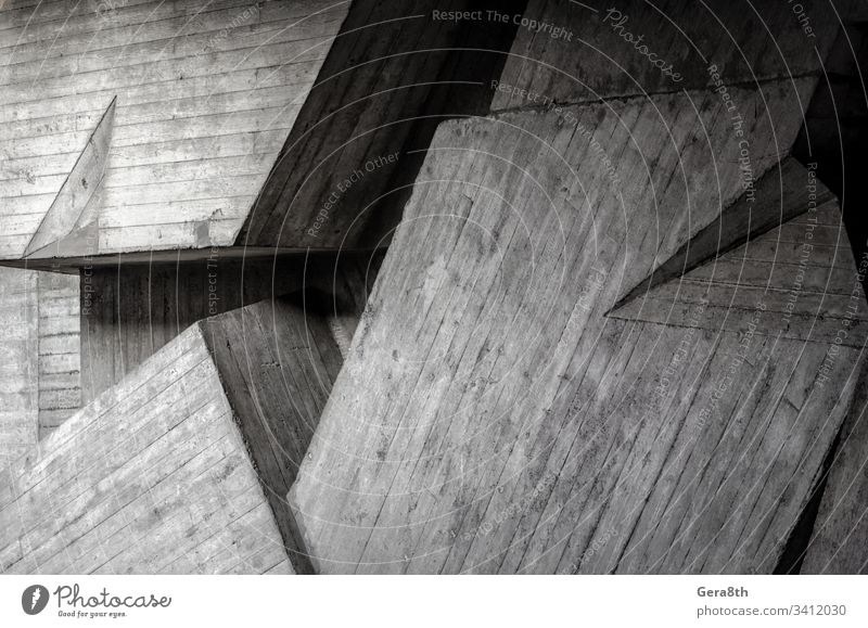 fragment of a gray concrete wall abstraction angle architecture background black blank blocks building curve dark design gloomy house light line modern pattern