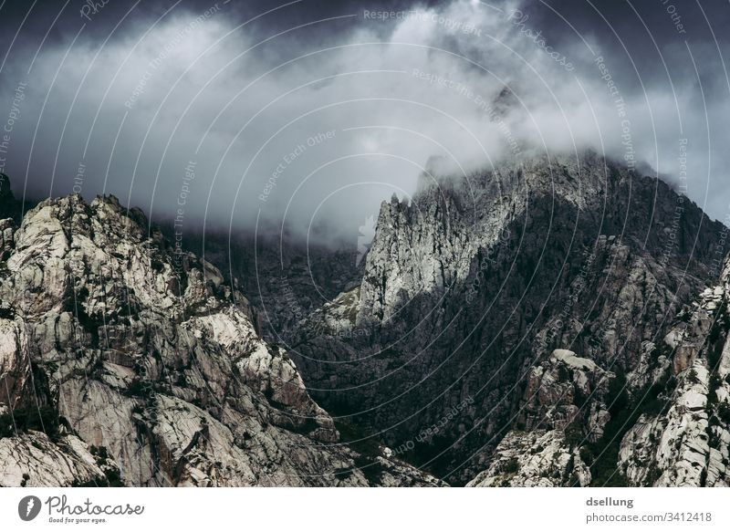 Rugged mountain peaks wrapped in dark clouds Europe Freedom Contrast cloudy Adventure Nature Subdued colour Deserted Day Colour photo Exterior shot Gray Wild