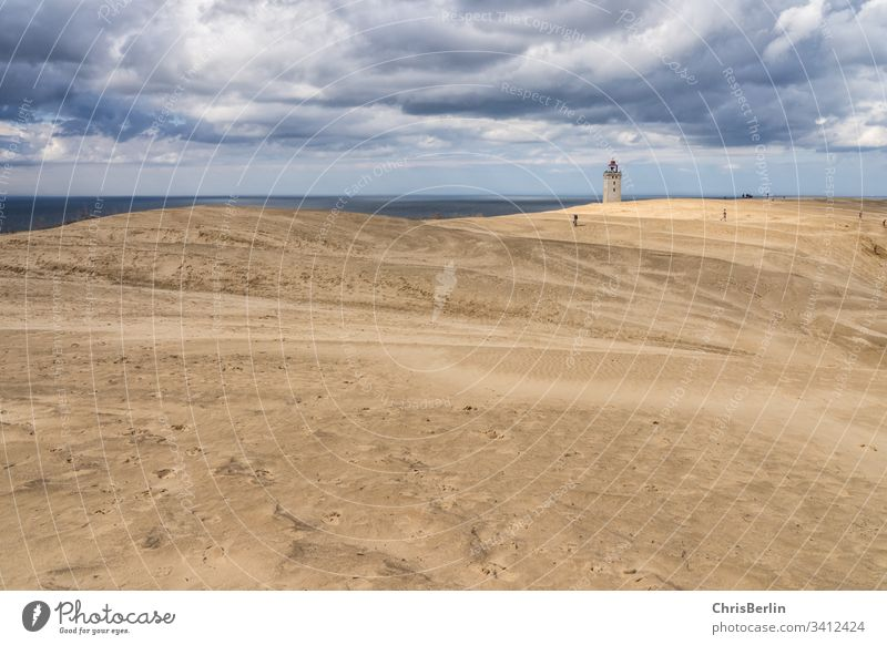 Lighthouse in the dunes Sand Blown away Strang North Sea Clouds Sky Exterior shot Colour photo Coast Landscape Nature Vacation & Travel Tourism destination