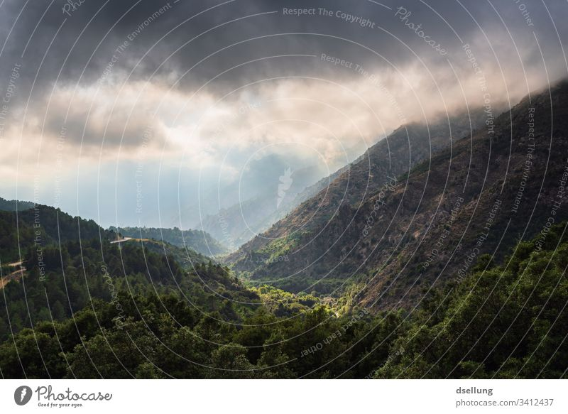 View of several levels of mountains with sunrays in cloudy weather Beautiful weather Expedition Climate change Environment Blue Weather Panorama (View) Light