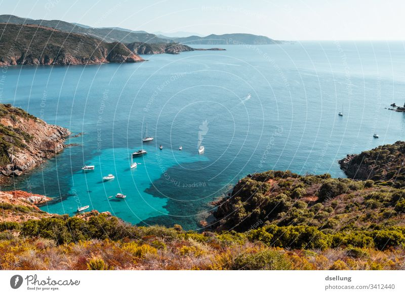 Turquoise sea with shipping traffic from a peninsula with mountain arms Blue Green Brown Landscape Vacation mood Ocean Corsica Boating trip Sky Relaxation