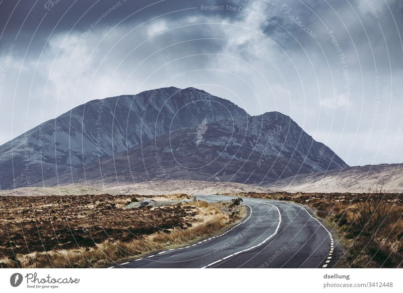 Simple road in Ireland with mountain in the background Panorama (View) Deep depth of field Day Copy Space bottom Deserted Exterior shot Colour photo