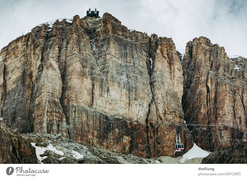 Rock face with cable car in the Dolomites Mountain Hiking South Tyrol Climbing Wall of rock Colour photo Relaxation Bizarre Effort Adventure Enthusiasm Gray