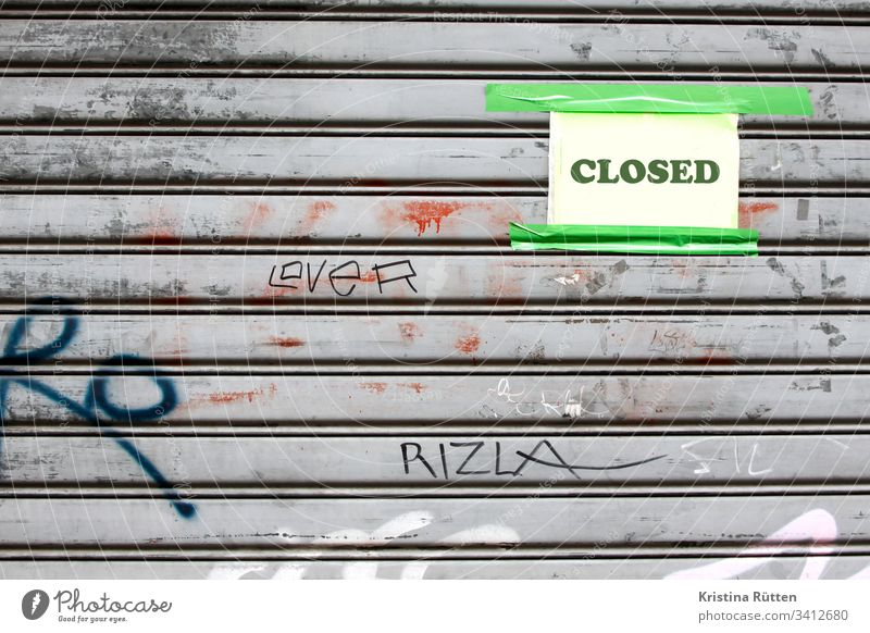closed shield on closed roller shutter Closed Roller shutter too opening hours holidays vacation bankrupt bankruptcy broke Illness Quarantine case of death