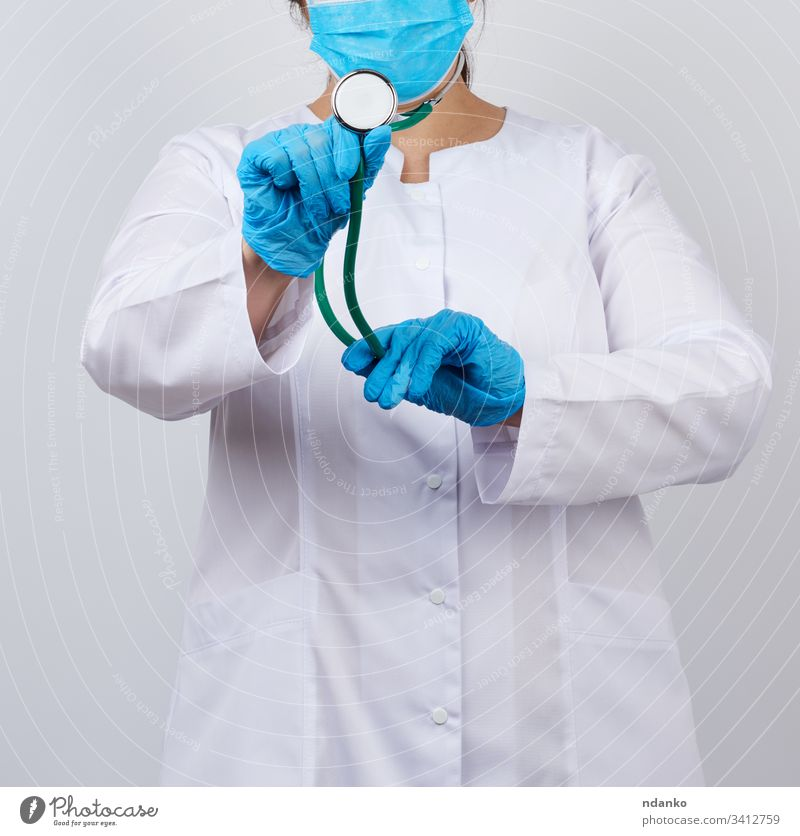 medic woman in a white coat and mask, wearing blue medical latex gloves adult care caucasian check clinic concept doctor equipment female girl hand health