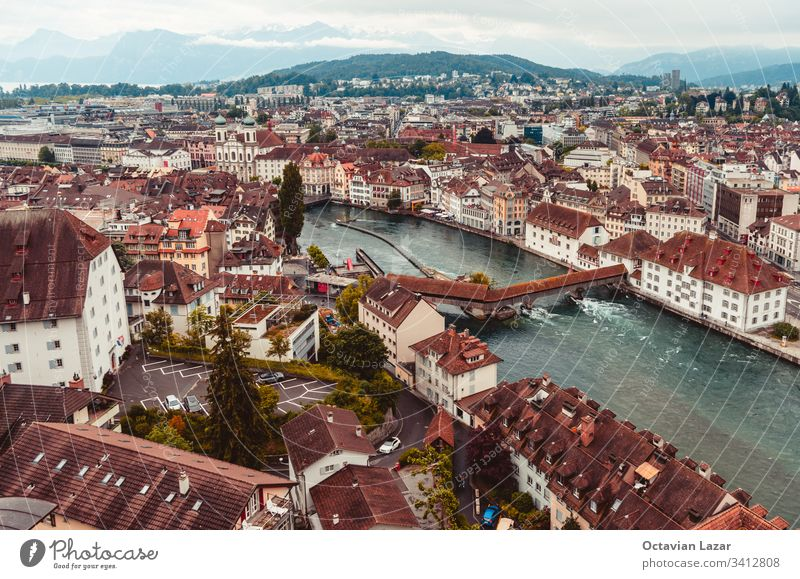 Aerial view of the city of Lucern Switzerland on an overcast day mountains in the background architecture travel town switzerland lucerne swiss europe tourism