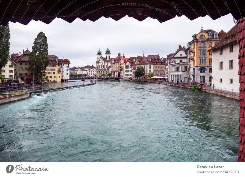 View from Lucerne's Speuerbrucke bridge reuss river old town building in the background architecture attraction beautiful blue canton chapel chapel bridge