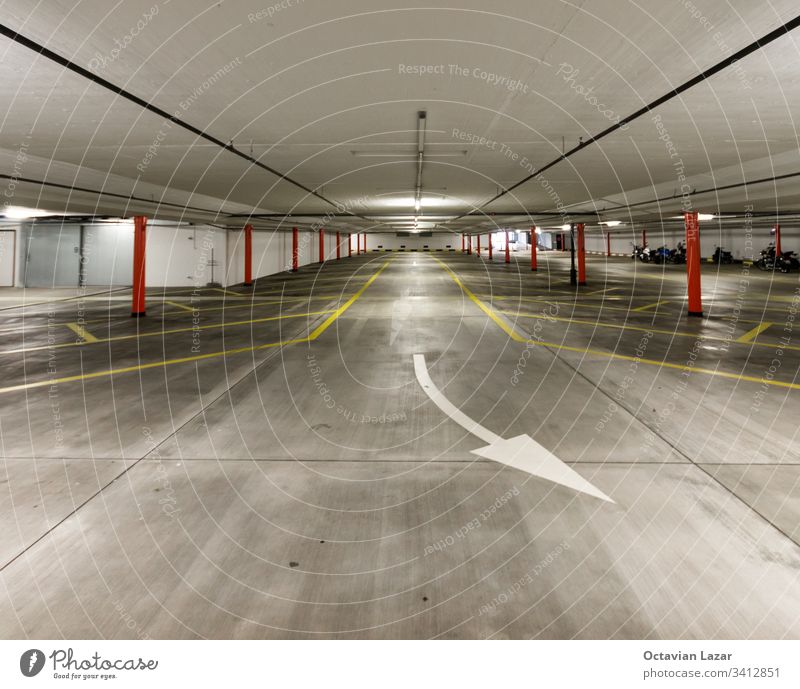 Empty illuminated underground car park wide angle shot no cars indoor architecture garage nobody interior empty building inside white place floor vehicle