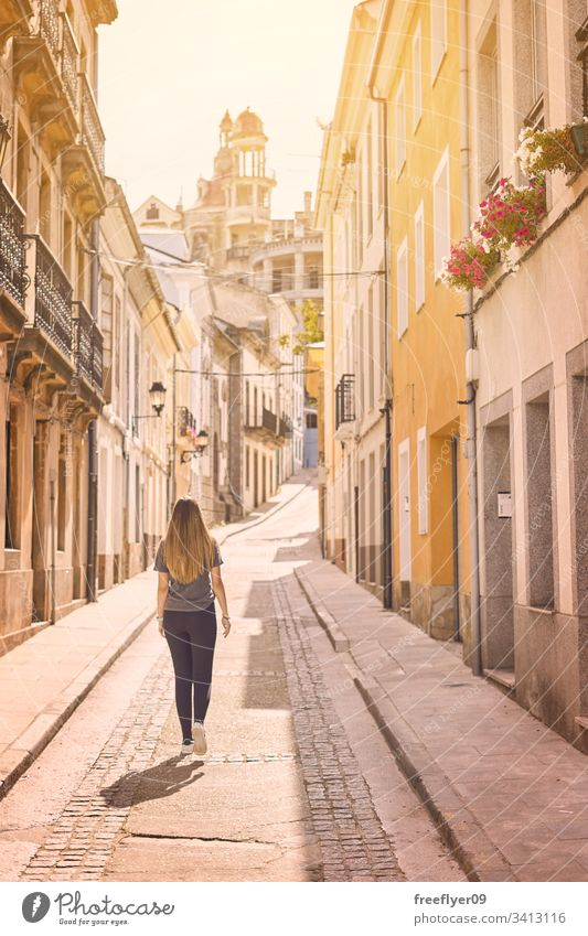 Young woman walking by the streets of the northern Spain ribadeo galicia tourism hiking one culture shape tour tourism detail travel place urban modernism lugo