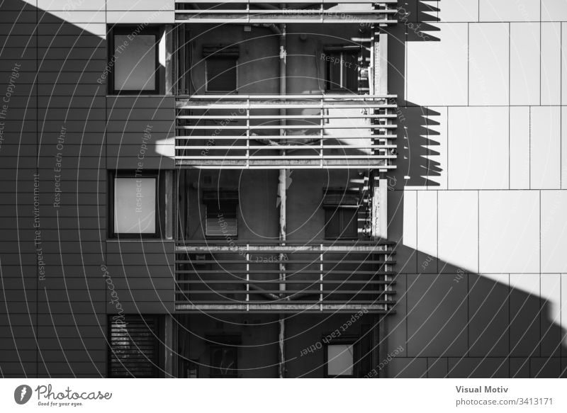 Balconies of a residential building in black and white facade windows balconies architecture architectural architectonic urban concrete structure shapes