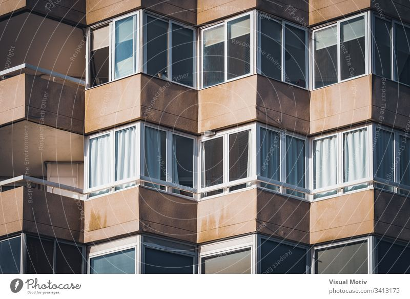 Balconies of an urban residential building facade windows balconies architecture architectural architectonic concrete color structure geometric geometrical