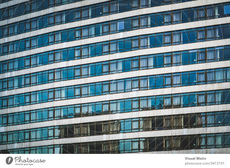 Rows of glazed windows of an urban building facade architecture architectural architectonic concrete color structure shapes abstract outdoors glass nobody