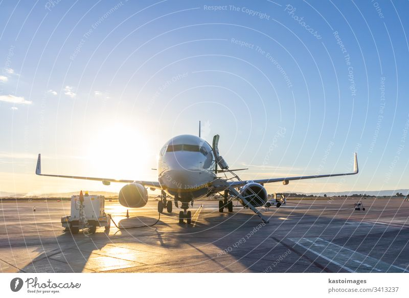 Passenger airplane on airport runway at sunset. transportation travel business jet sky airline engine terminal flight aircraft departure wing arrival aviation