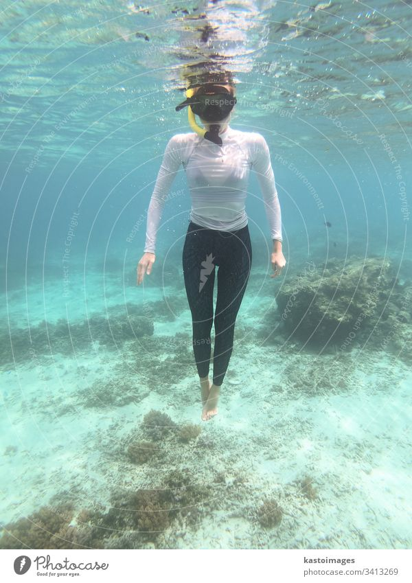 Woman with mask snorkeling in blue sea. woman water underwater tropical clear fun ocean dive female lifestyle summer young marine face goggles leisure holiday